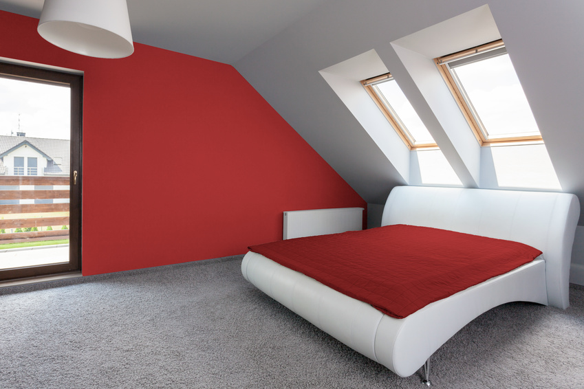View of white and red modern bedroom